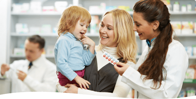 pharmacist assisting customer with her child